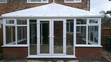 Edwardian conservatory with opel poly carb roof.